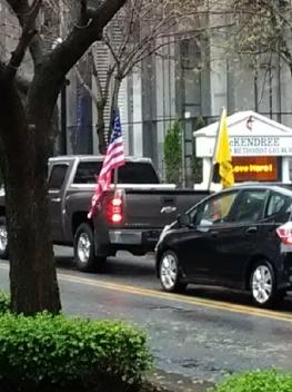 Vehicle with Gadsden Flag riding through downtown Nashville.